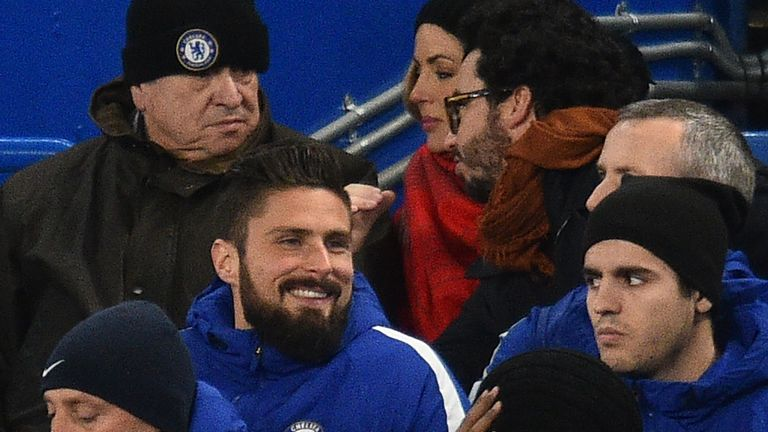 Olivier Giroud (left) sits next to striker partner Alvaro Morata (right)