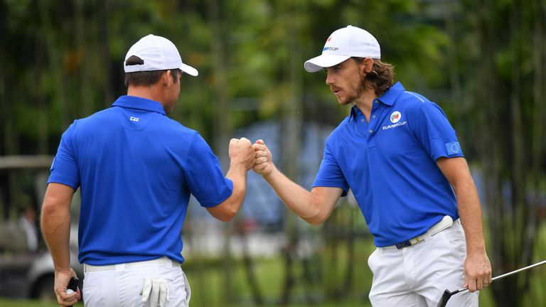 Tommy Fleetwood celebrates victory in the top match with Paul Casey