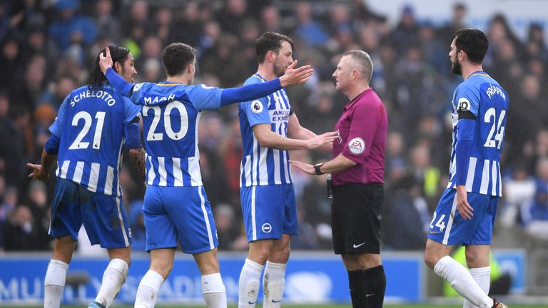 Brighton players appeal to referee Jon Moss after being denied a penalty against Chelsea, but did the official make the right call?