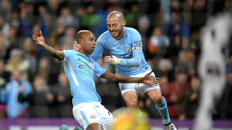 Fernandinho celebrates his side's opening goal with team-mate David Silva