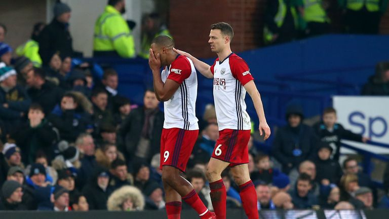 A visibly upset Salomon Rondon is consoled by Jonny Evans following a collision that resulted in injury to James McCarthy