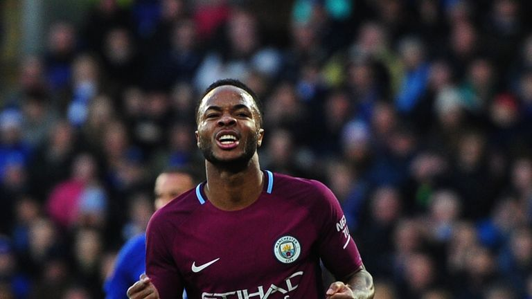 Raheem Sterling celebrates after putting Man City 2-0 up