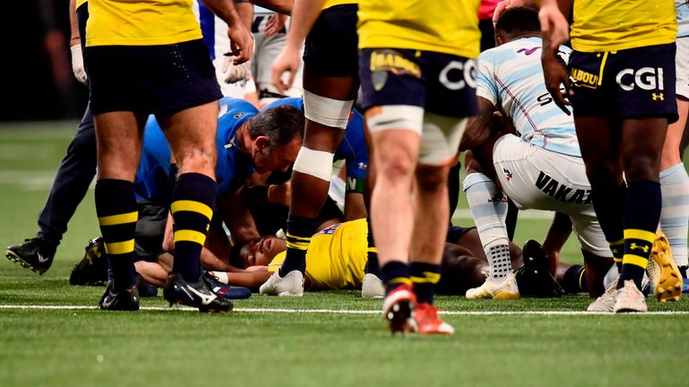 Samuel Ezeala receives treatment after being knocked unconscious in a collision with Virimi Vakatawa