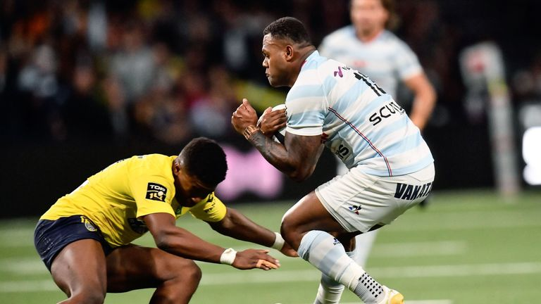 Virimi Vakatawa (R) is tackled by Samuel Ezeala during the France Top 14 fixture between Clermont and Racing 92