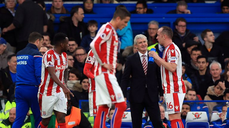 Stoke City manager Mark Hughes speaks to Charlie Adam during Saturday's defeat at Chelsea