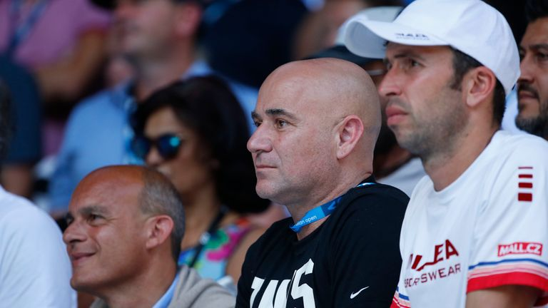 Coaches Agassi (left) and Radek Stepanek watch Djokovic in action against Monfils