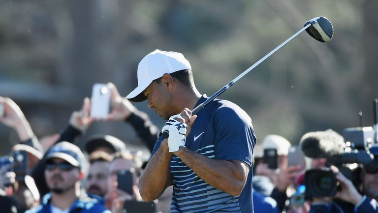 Woods shows his frustration after a wayward tee shot on the 13th
