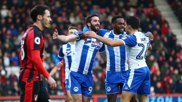 Wigan's Will Grigg celebrates scoring with Gavin Massey and Reece James against Bournemouth in the third round