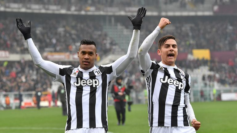 Alex Sandro (L), on target for Juventus, celebrates with Paulo Dybala