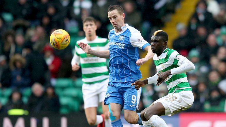 Celtic's Eboue Kouassi (right) challenges St Johnstone forward Steven MacLean