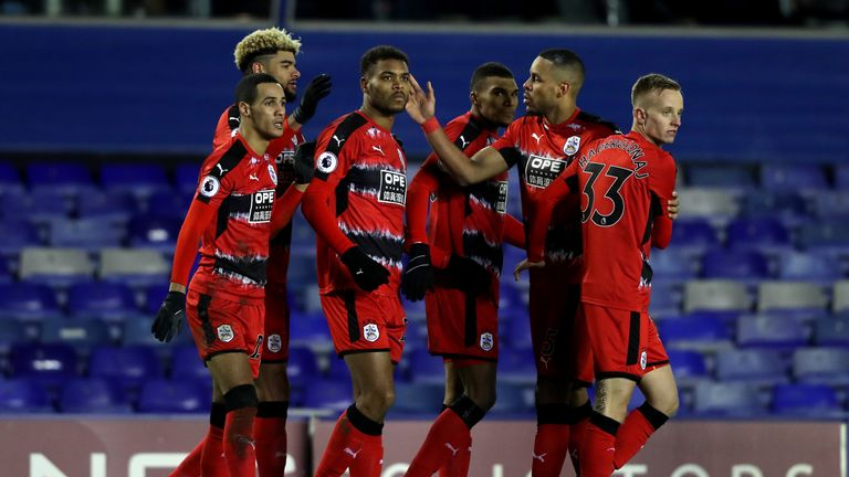 Steve Mounie of Huddersfield Town celebrates with team-mates