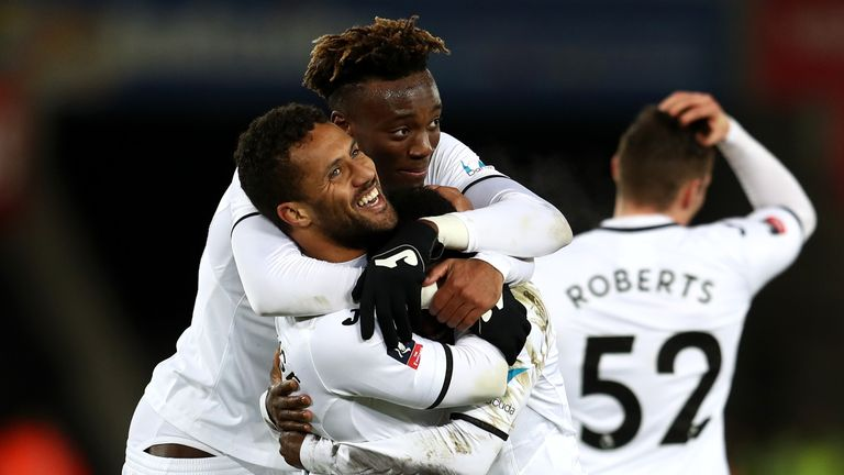 Wayne Routledge celebrates scoring the sixth Swansea goal with Tammy Abraham