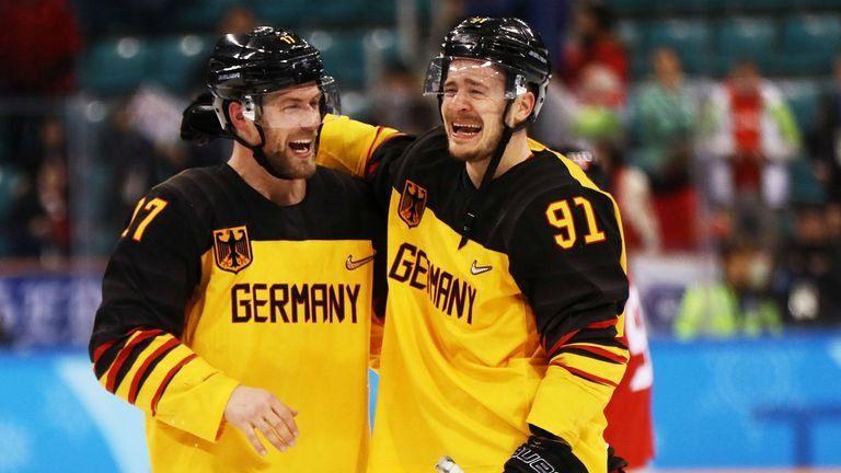 Germany celebrate after defeating Canada 4-3 in the  men's semi-finals