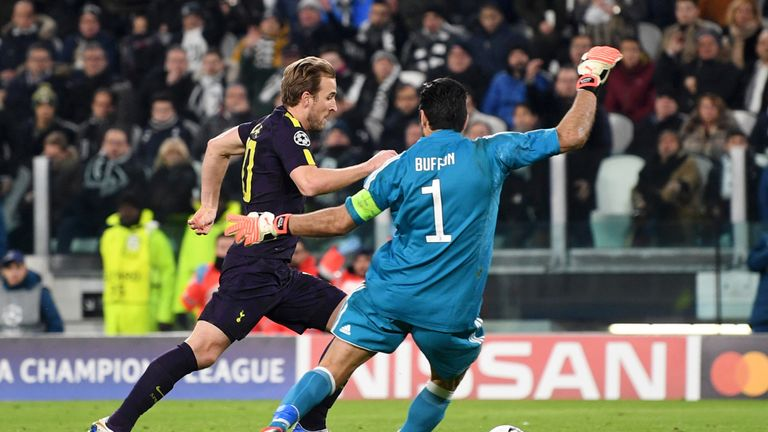 Kane rounds Gianluigi Buffon before scoring Tottenham's first goal