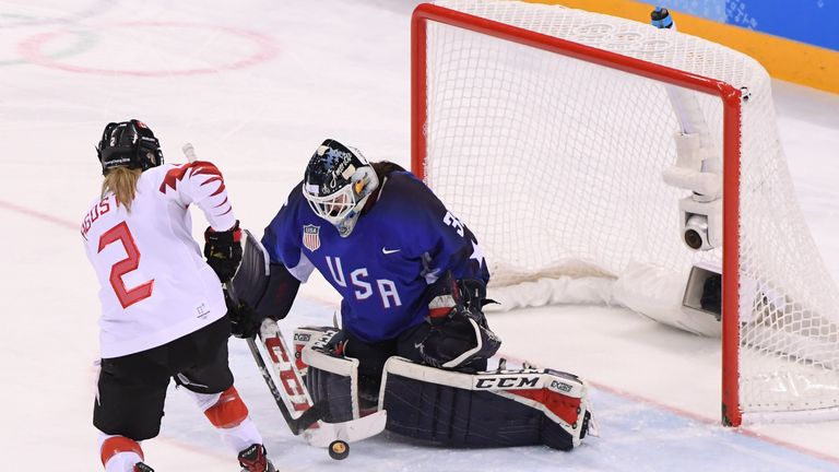 Madeline Rooney #35 of the United States makes a save against Meghan Agosta #2 of Canada