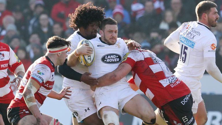 Jimmy Gopperth of Wasps is tackled with the ball