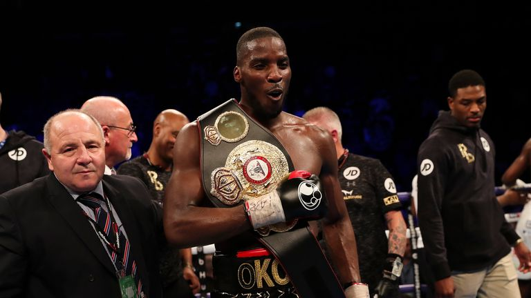 Okolie celebrates victory with wide scores of 98-89, 96-90 and 97-89