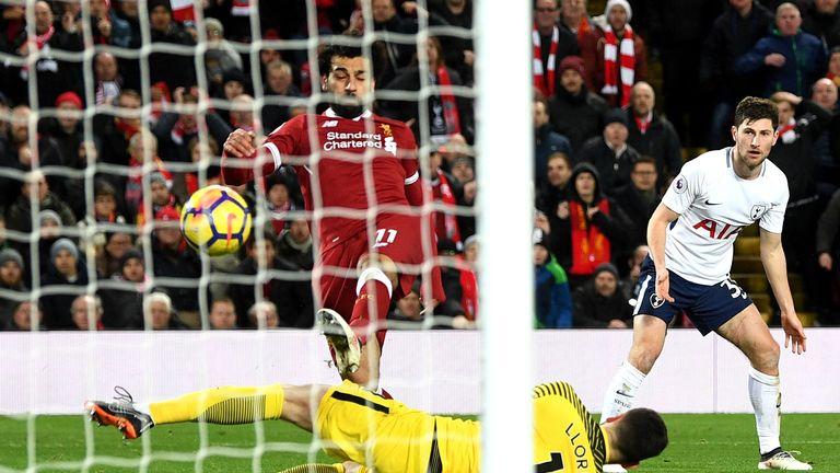 Salah lifts the ball over Hugo Lloris to put Liverpool ahead after 91 minutes