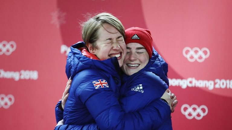Yarnold and Deas embrace after winning gold and bronze