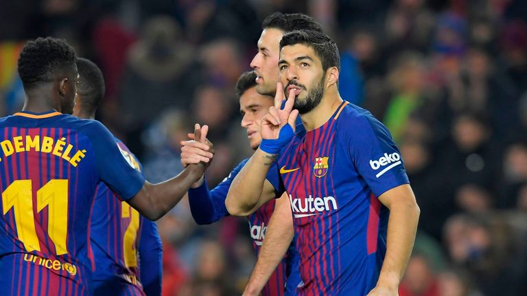 Luis Suarez scored a hat-trick as Barcelona responded in style to Girona's early opener