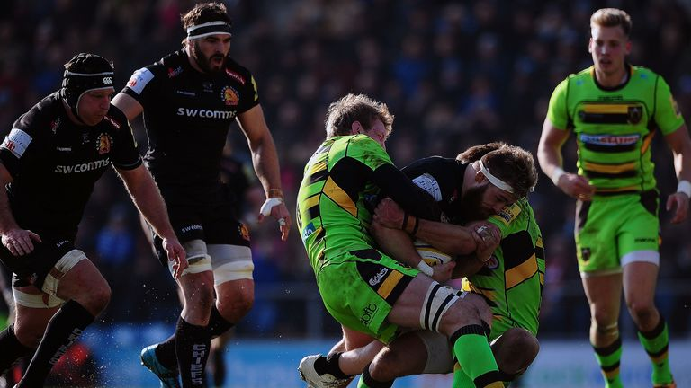 Luke Cowan Dickie of Exeter Chiefs is stopped by the Northampton defence