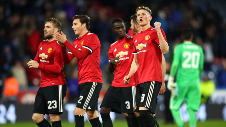 Manchester United players applaud fans after the win at Huddersfield