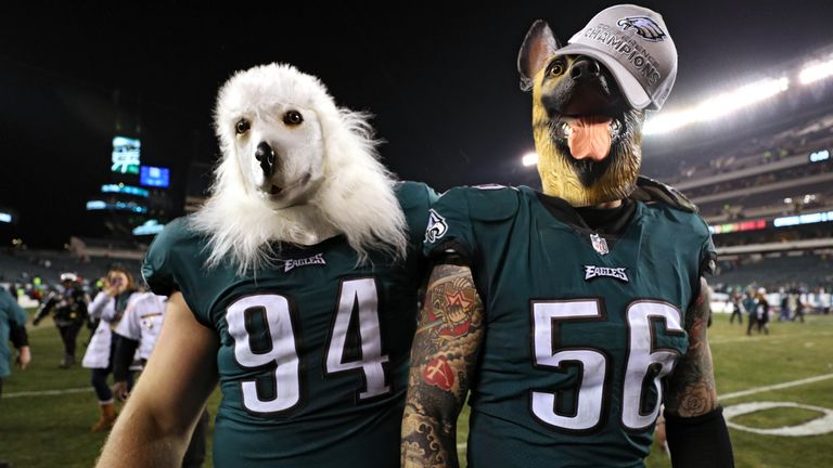 PHILADELPHIA, PA - JANUARY 21: Beau Allen #94 and Chris Long #56 of the Philadelphia Eagles celebrates their teams win while wearing a dog masks over the M