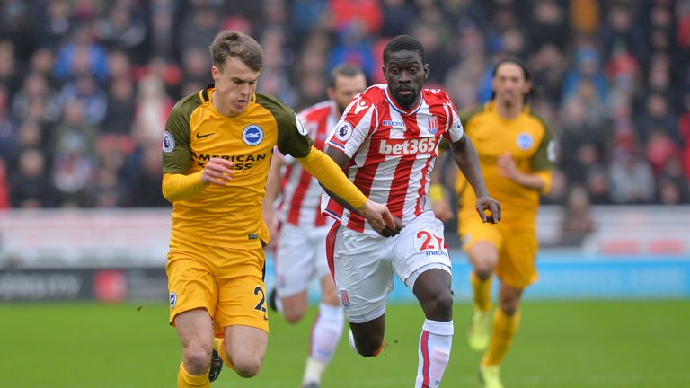 Solly March is chased down by Badou Ndiaye (right) at the bet365
