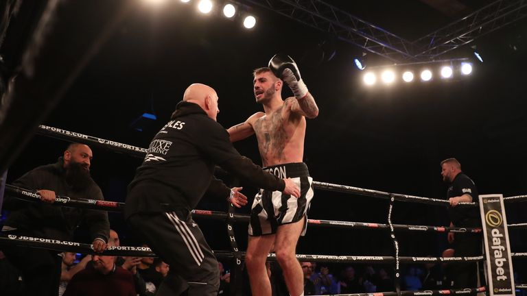 The champion celebrates his swift stoppage win over Joe Murray