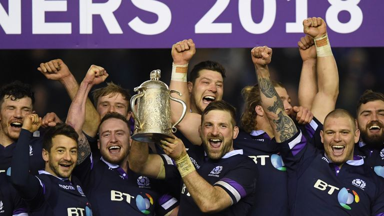 Scotland celebrate with the  Calcutta Cup  after victory against England