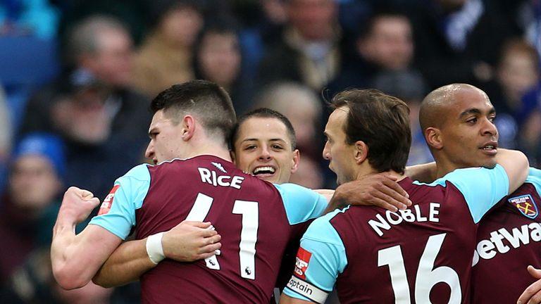 West Ham United's Javier Hernandez celebrates scoring their equaliser at the AMEX Stadium