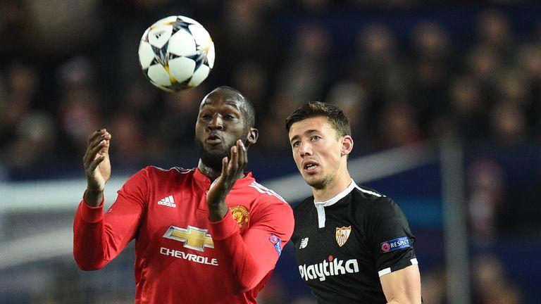 Romelu Lukaku vies with Sevilla defender Clement Lenglet