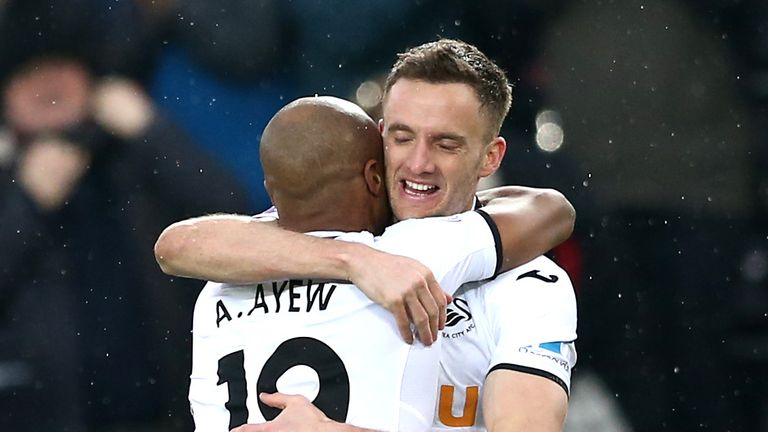 Andy King is congratulated by teammate Andre Ayew after making it 3-0