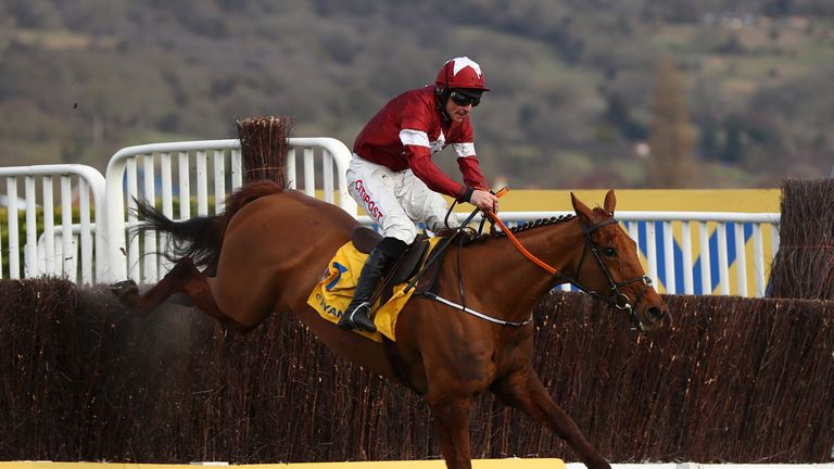 Balko Des Flos ridden by Davy Russell jumps the last on their way to victory in the Ryanair Chase