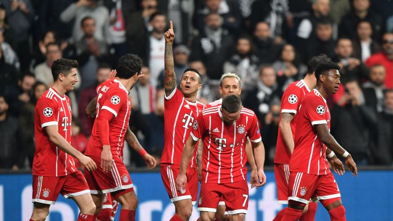 Thiago (centre) extended Bayern's lead further in the 18th minute