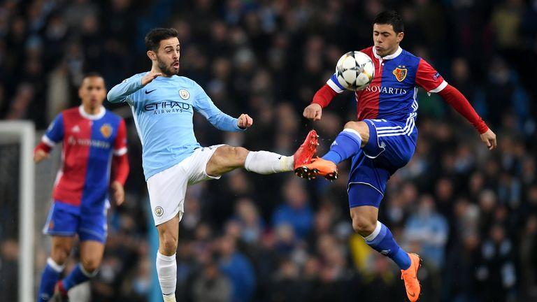 Bernardo Silva and Blas Riveros battle for the ball