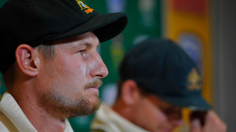 Steven Smith (capt) and Cameron Bancroft of Australia (L) address the media after the latter was caught tampering with the ball against South Africa