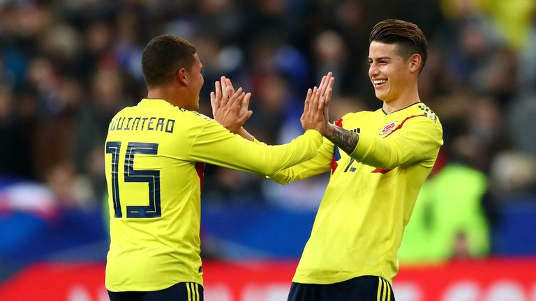 Juan Quintero celebrates with team-mate James Rodríguez after scoring Colombia's winner in Paris