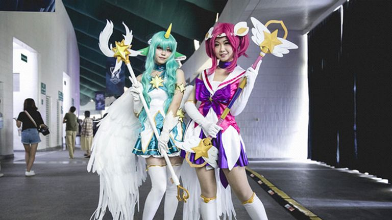 Two cosplayers at the 2017 World Championship dressing up as game characters Soraka and Lux. Soraka was considered highly 'meta', while Lux is barely played at all on the professional level (credit: Riot Games)