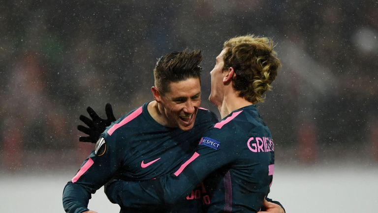 Fernando Torres (left) celebrates the first of his two goals in Moscow