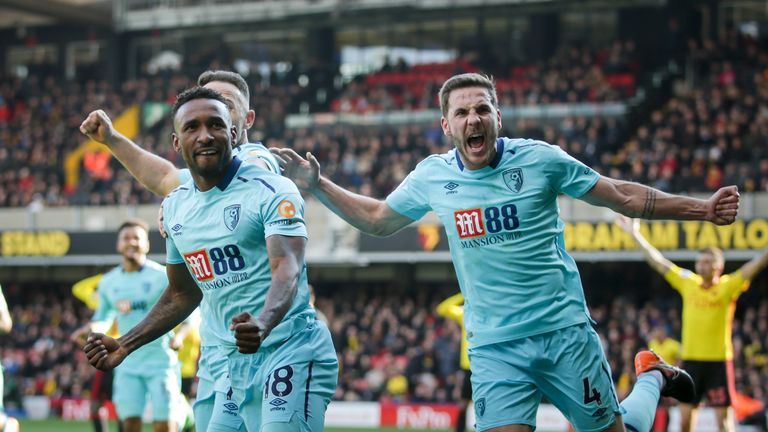 Jermaine Defoe celebrates after scoring a late equaliser for Bournemouth at Vicarage Road