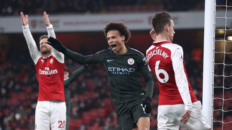 Leroy Sane celebrates after scoring Man City's third goal