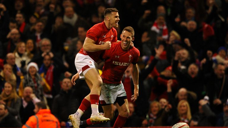 Liam Williams (R) celebrates scoring his side's first try with Gareth Davies