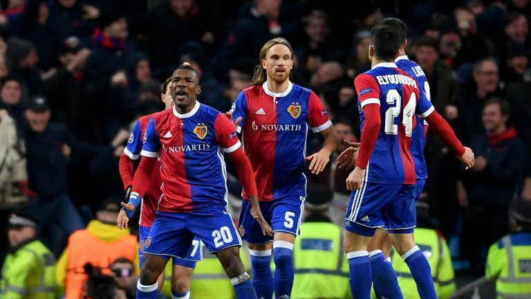 Michael Lang celebrates with Basel team-mates after scoring against Manchester City