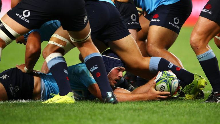 Michael Wells of Waratahs scores a try in round 2