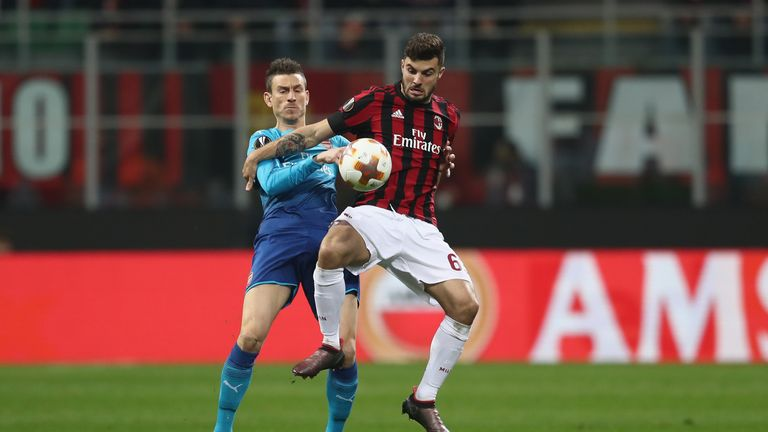 Arsenal battled to a vital 2-0 win at AC Milan