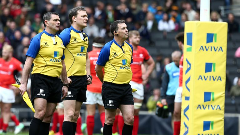Officials look up at the big screen during an Aviva Premiership game