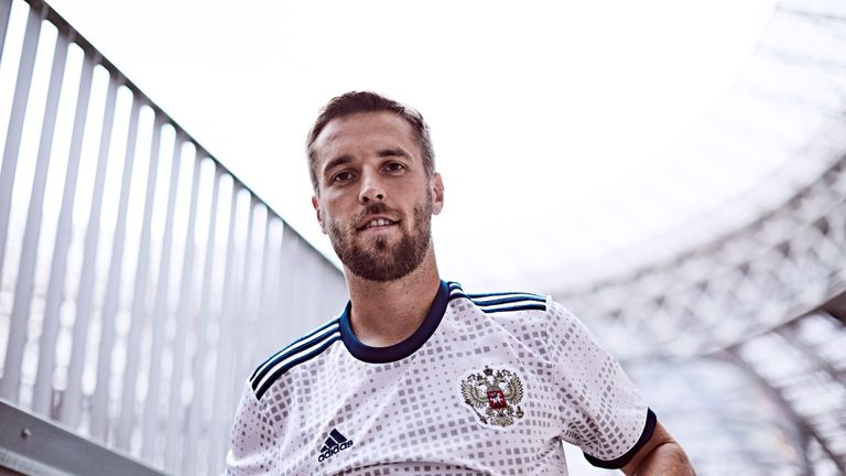 d1419cc38 Dmitri Kombarov models the new Russia World Cup 2018 away shirt (credit   adidasUK)