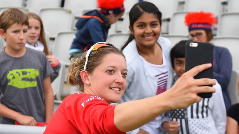 Taylor, of Lancashire Thunder, posing with fans during the 2017 Kia Super League