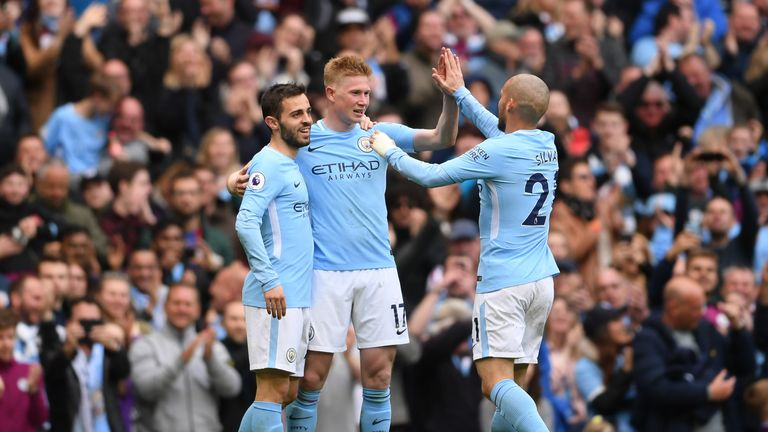 Kevin De Bruyne is congratulated after his sensational strike put Man City 3-0 ahead